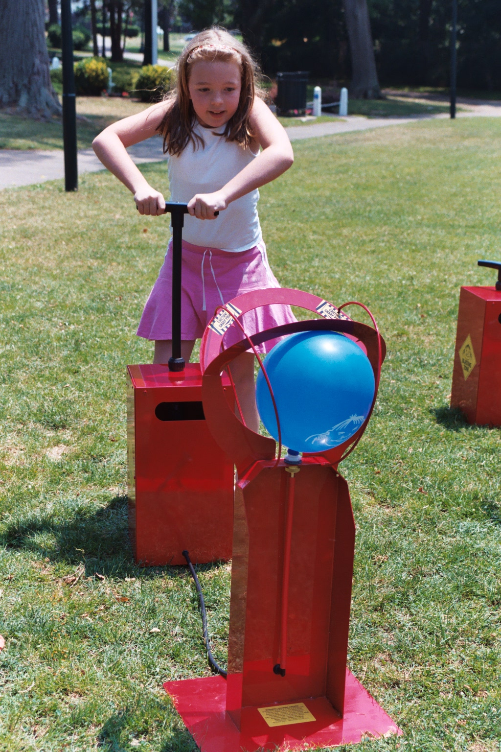 A young girl is pumping away, having fun playing with Boom Blasters she rented from Bette's.
